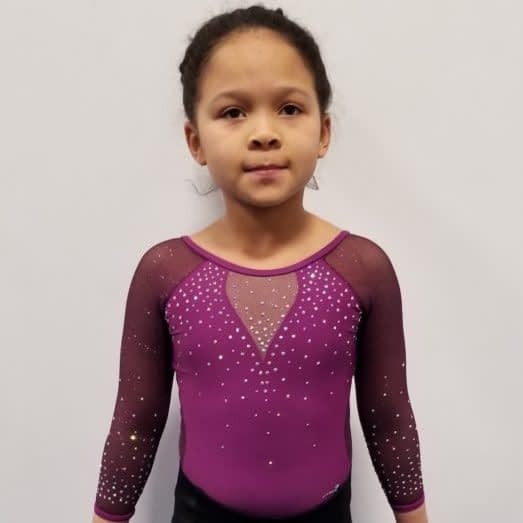 young gymnast with purple leo
