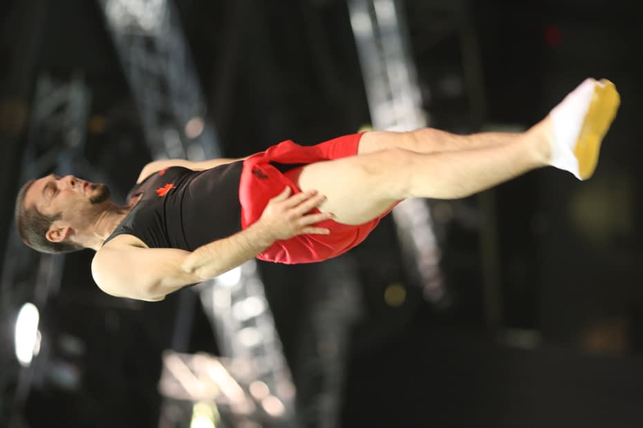 male trampoline athlete twisting in the air