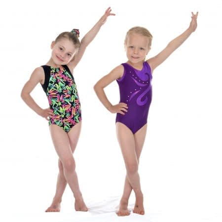 two young gymnasts presenting with one arm up