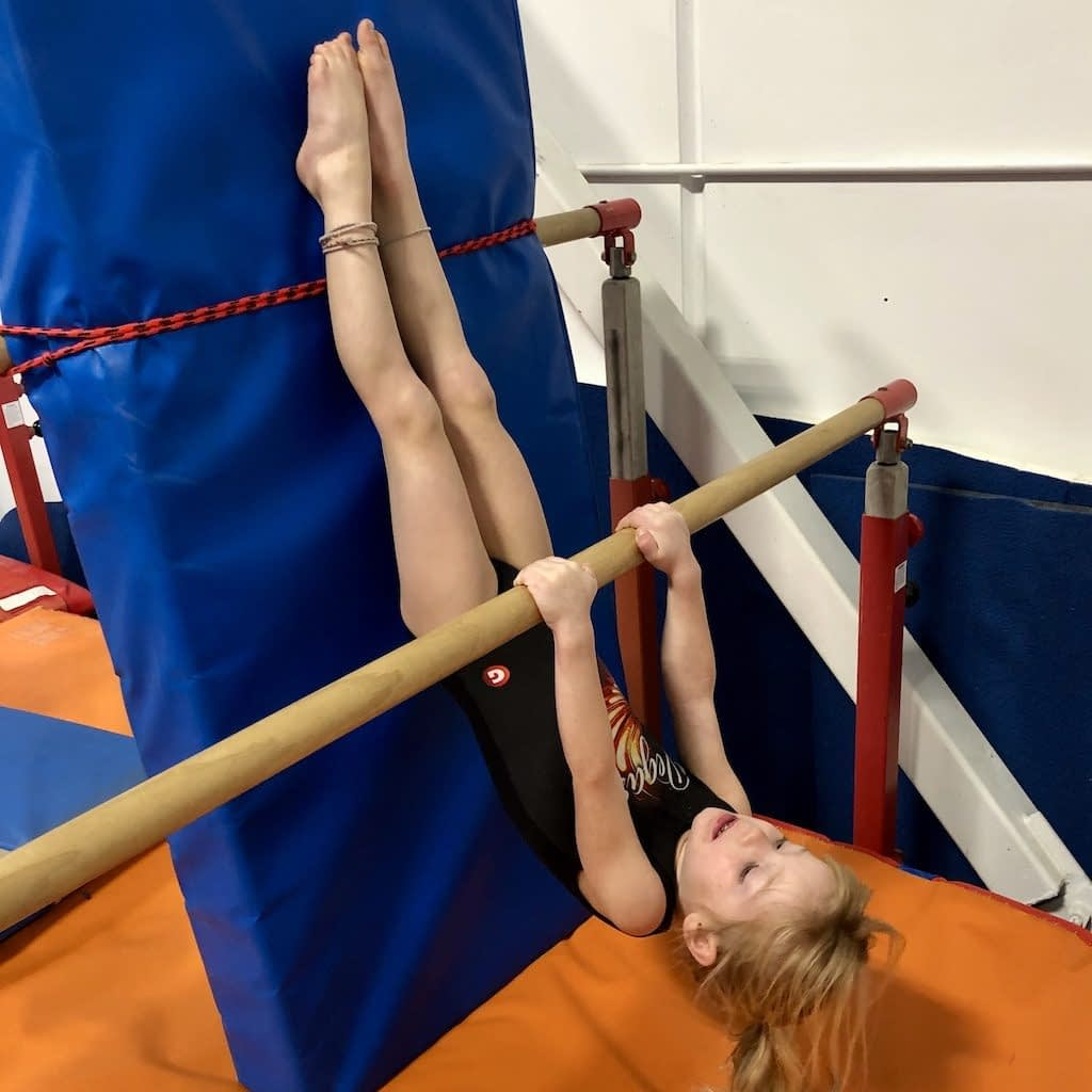 hanging upside down on bar 1024