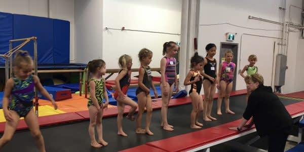 camp kids lined up on tumble track