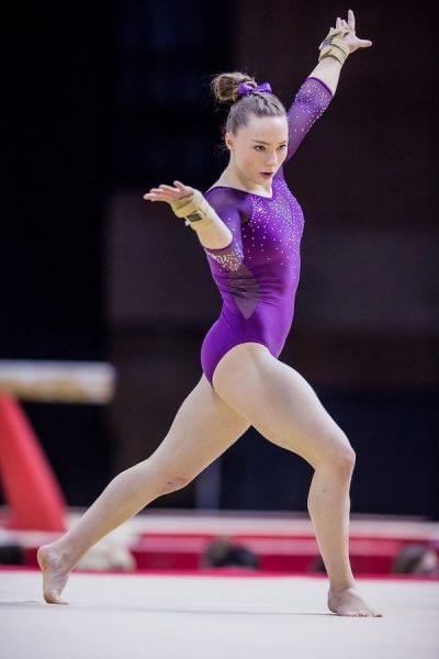 gymnasts on floor